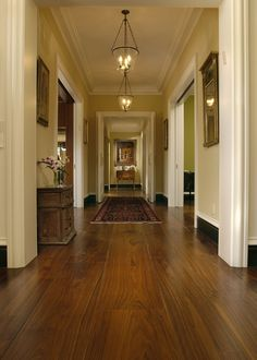 Wide Plank Walnut flooring from Carlisle Wide Plank Floors, made to order, and hand crafted for this California home, keeps a consistent look and makes this narrow gallery hallway look even bigger and more beautiful. Wide Plank Flooring, Wooden Flooring, Flooring Ideas, Walnut Floors, Hardwood Floors, Dark Hardwood, Dark Wood, Hallway Designs, Hallway Ideas