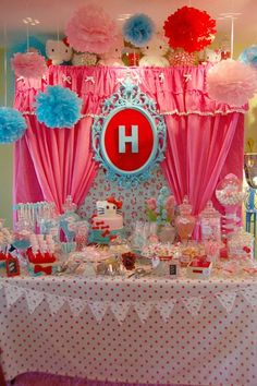 Hello Kitty party- polka dot table cloth and colorful poof balls to hang
