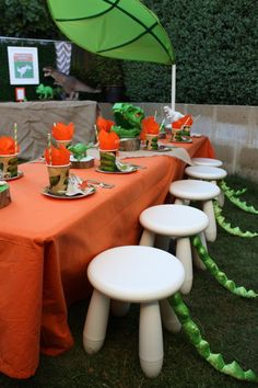 Dinosaur Birthday Party table! See more party ideas at CatchMyParty.com! Love the tails on the chairs!