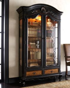 """""""Octavia"""" Bookcase. Glass doors, glass sides, removable/adjustable glass shelves trimmed in wood, and with touch-controlled light inside."""
