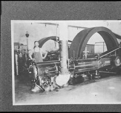 A man standing by part of a steam engine at Redlands Steam Plant. :: Southern…
