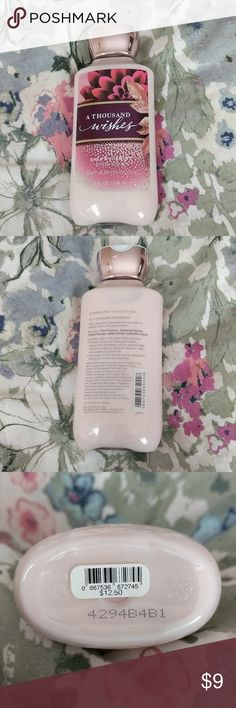 Bath & Body Works A Thousand Wishes body lotion This is a Shea & Vitamin E body lotion in A Thousand Wishes. Brand new, unused. 8 FL OZ Bath & Body Works Other