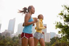 Stock Photo : Friends running in urban park