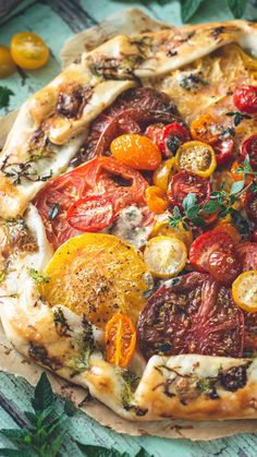 This Rustic Heirloom Tomato Tart recipe is an easy addition to any summer picnic, teatime, or meal. But it's delicious enough to be the main event. Packed with heirloom tomatoes, fresh herbs, mouthwatering cream, and savory, crumbly cheese. Easy Tart Recipes, Veggie Recipes, Appetizer Recipes, Appetizers, Tomatoe Tart, Tomato Tart Recipe, Heirloom Tomato Tart, Heirloom Tomatoes, Fresh Vegetables