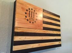 Show your patriotism with my hand crafted wooden Home Defense concealed flag art. Constructed from repurposed pallet wood to make it look truly rustic. This will look great and impress your visitors. Not to mention serve the additional purpose of home defense in case you need quick access. Magnetic lock is available for an additional $10 in case you have little ones around. This item includes Kaizen high desity gun foam that is easily customizable to fit your particular sidearm. Mounting…