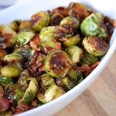 Perfectly Roasted Brussels Sprouts with Bacon- the Holy Grail for Brussels sprout lovers! These are salty, caramelized and roasted to perfection.