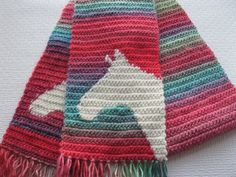 Handmade, colorful horse scarf. This scarf is hand crocheted with a multicolored roving acrylic yarn. The horse head silhouettes are crocheted with