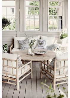 What a wonderful porch to spend time on. I like the subtlety of the colors..you can progressively add more color in each room