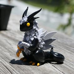 Black and Gray Feathered Dragon Sculpture by MiniMythicalMonsters on DeviantArt