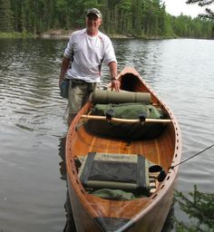 cedar strip canoe at a portage