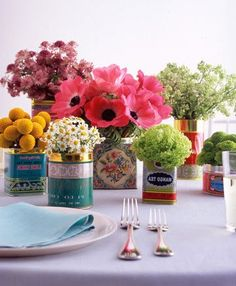 Quirky budget idea of using old tins as flower vases for your wedding tables!