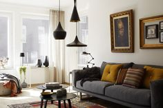 black, grey, brown, and warm ochre-gold provide a cozy, yet clean aesthetic in this home.