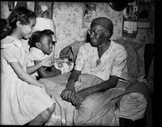 """Two girls with former slave Sabre """"Mother"""" Washington, Pittsburgh, early 1950s. Teenie Harris. [Carnegie Museum of Art] One of the girls, a neighbor of Washington's, discovered the photograph years later. Washington, who grew up in South Carolina..."""