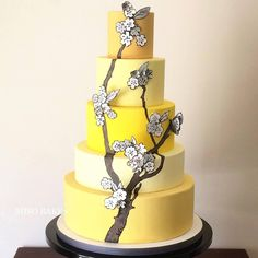 """Yellow and Grays. August 2014. #misobakes #fondant #cake #handpainting…"
