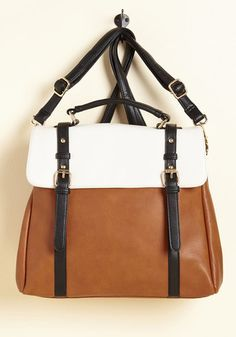 Can we all pause for a moment to appreciate the utter awesomeness of this rocker-chic bag? Equipped with two pocketed compartments, a suede flap that snaps shut, and the option to transform into a backpack, this brown, white, and black carryall is almost too cool to be true.