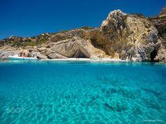 A beach on Ikaria Island, Greece. Photography by Nikos Chatziiakovou.