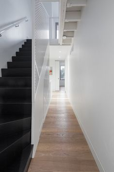A black staircase lined with perforated white walls zig-zags up through this renovated city dwelling by Canadian studio Post Architecture. Architecture Office, Architecture Photo, Black Staircase, Staircase Ideas, Architectural Section, Compact Living, Prefab Homes, White Walls, Midcentury Modern