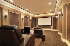 Picture of stadium seating home theater room. Material between trim for sound quality