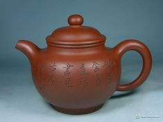 Purple clay teapot, a distinguished kind of pottery with decorative patterns. Find more @http://www.chinatraveldesigner.com/travel-guide/culture/culture-relics/purple-clay-teapots.htm