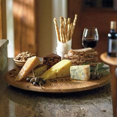 Where there is wine... There MUST be cheese...  I LOVE the use of a wine barrel lid as the cheese board...