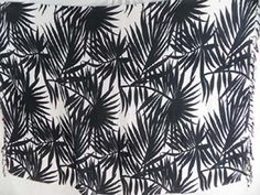 black palm leaf on white background sarong - http://www.wholesalesarong.com/blog/black-palm-leaf-on-white-background-sarong/