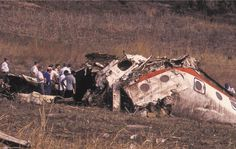 The section of fuselage from just above the wing lying in pieces on the ground at Mbuzini. Some South African police uniforms can be seen.