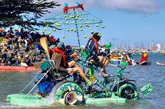 What's 11 feet tall, breathes fire, and engages dozens of bicycle gears to cross land, sand, and sea? A vehicle built to conquer California's Kinetic Grand Championship, a three-day, 42-mile race of some of the strangest homemade conveyances around.
