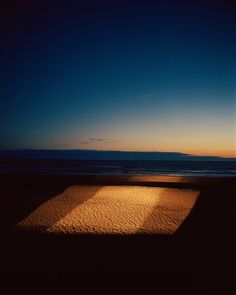 Gregory Halpern - really like the shapes made in the dark sand it really stands out and is nice reflecting in front of the coloured sky