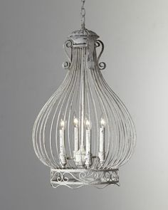 """Onion-Shaped Cage Chandelier.  A wire cage forms the shape of an onion and surrounds four 60-watt candelabrum bulbs to cast a soft glow from above.  Handcrafted of steel.  Hand painted.  18""""Dia. x 30""""T."""