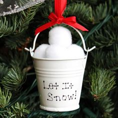Made with supplies from the dollar store, these ornaments look like a bucket of snow balls and only take a few minutes to make.