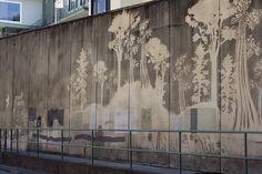 Reverse graffiti wall of trees.