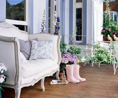 These homeowners blend the romance of France with chic cottage flair in their San Francisco Victorian Outdoor Living: An upholstered French loveseat dresses up the front porch, which overflows with containers of foxglove and delphinium. Cottage Porch, Cottage Style, French Cottage, White Cottage, Cottage Chic, Summer Porch Decor, Dear Lillie, Outdoor Living, Outdoor Decor