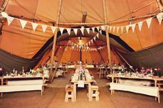 A teepee tent interior. Photo Source: Boho Weddings. #weddingtent #teepeetent