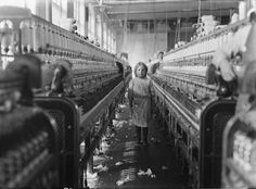 Young girl working as a child laborer in a textile mill in South Carolina. Circa 1908