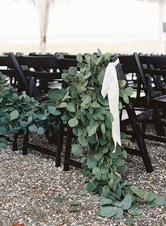 Eucalyptus greenery garland on ceremony chairs | ceremony decor