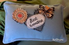 hand made motto cushion from wool fleecy fabric with applique. Made by me