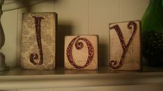 DIY Christmas blocks. Joy blocks craft. Vintage Christmas. Glitter Hobby Lobby letters. Scrapbook paper.