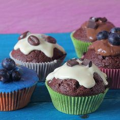 Easy muffin decorating - blueberries chocolate coffee beans and chocolate chunks. And frosting of course.