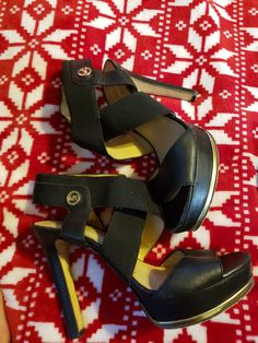 Michael Kors heels in size 7 1/2. Well used but still alot of life left in them in them. Straps are elastic for a perfect fit.