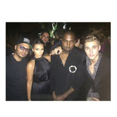 Pin for Later: Kim Kardashian and Kanye West Party With Too Many Stars to Count  Kim and Kanye posed for a picture with Justin and restaurant and nightclub entrepreneur Richie Akiva. Source: Instagram user kimkardashian