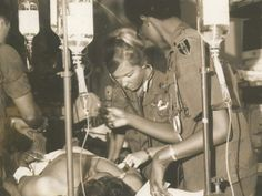 Vietnam War Medical - Nurses at work on wounded soldiers