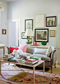 couch with pattern, kilim rug, sleek coffee table, eclectic gallery wall, subtle wall color