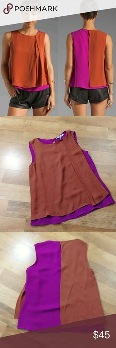 Halston Heritage Boat neck Color Block Tank Halston Heritage Boat neck Color Block top in purple magenta and burnt orange. Size 2  Measures 17 inches pit to pit, 22 inches shoulder to hem  Bundles of 3 or more items receive 20% off Halston Heritage Tops Tank Tops