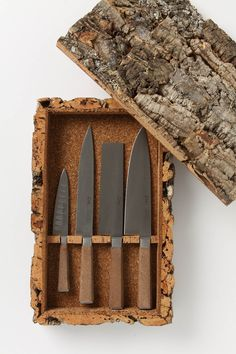 A Craggy bark case holds a set of stainless steel cork-handled cooking knives.  Anthropologie