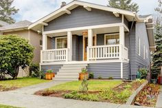 Grey Craftsman Style House With White Porch. Stock Image - Image of residential, architecture: 23908829 Home Buying Tips, Buying Your First Home, Building A Pole Barn, Small House Living, White Porch, Starter Home, Thing 1, First Time Home Buyers, Home Ownership