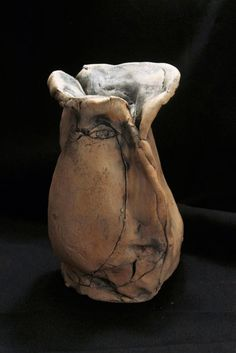 Clay, Fired Ceramics #sculpture by #sculptor Ulisses Santiago titled: 'Hitchcock (abstract Caricature ceramic sculptures)'. #UlissesSantiago