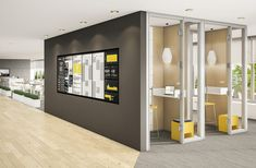 A highly visible media wall offers the latest company news and various RSS feeds to help workers engage with the organization's activities. Enclosed phone booths provide an easily accessible and private place for visitors to take a call or write an email.