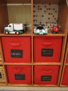 What a great idea for organizing toys! You can erase and add new labels as toys are phased out!