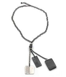 Tags necklace makes a totally fashion forward statement with its avante guard design of metal, faux leather, and crystals. $42.00