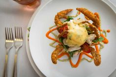 Soft shell crab and eggs,served over grits with greens, tomato, lump crab meat,at Commanders Palace brunch in New Orleans